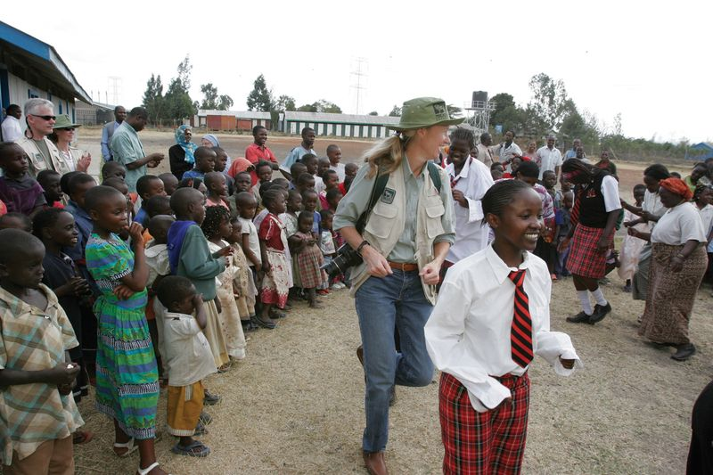 Micato Safaris Traveller Interacting with Locals